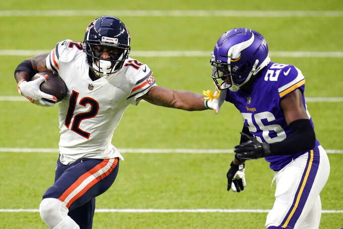 FILE - In this Dec. 20, 2020, file photo, Chicago Bears wide receiver Allen Robinson II (12) runs from Minnesota Vikings cornerback Chris Jones (26) after catching a pass during the second half of an NFL football game in Minneapolis. Robinson  insisted a contract negotiation that left him playing this season on the franchise tag rather than a multiyear deal did not give him a chip on his shoulder or an extra desire to show his worth. (AP Photo/Jim Mone, File)