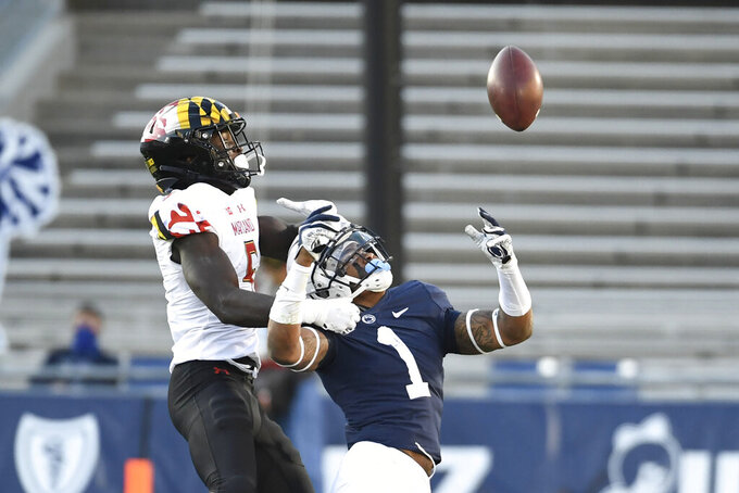 Penn State safety Jaquan Brisker (1) breaks up a pass intended for Maryland wide receiver Rakim Jarrett (5) in the second quarter of an NCAA college football game in State College, Pa., Saturday, Nov. 7, 2020. (AP Photo/Barry Reeger)