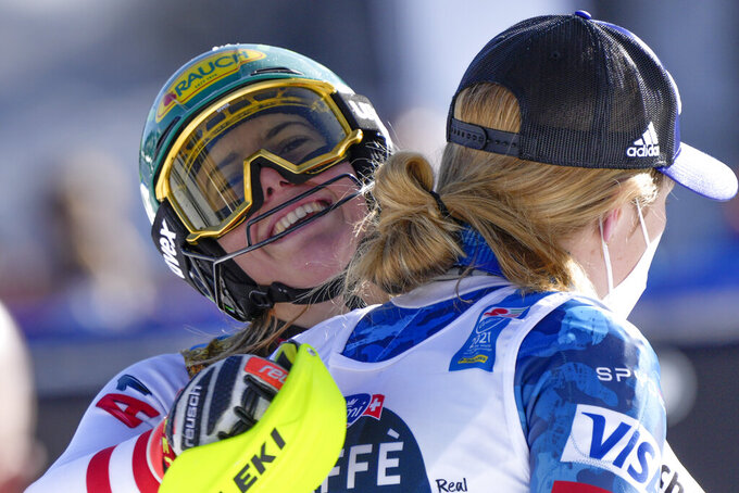 Austria's Katharina Liensberger, face to camera, winner of the women's slalom, celebrates with third placed United States' Mikaela Shiffrin, at the alpine ski World Championships in Cortina d'Ampezzo, Italy, Saturday, Feb. 20, 2021. (AP Photo/Giovanni Auletta)