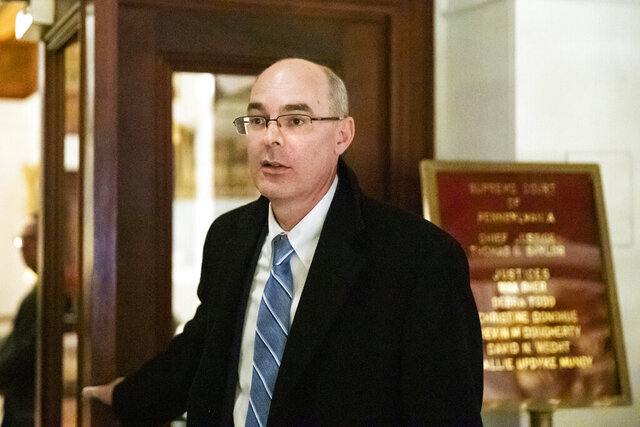 Former state prosecutor Frank Fina departs after oral argument before the Pennsylvania Supreme Court at the Pennsylvania Capitol in Harrisburg, Pa., Wednesday, Nov. 20, 2019. Fina faces possible law license suspension over his handling of a grand jury witness during the investigation into Penn State's response to complaints about Jerry Sandusky. (AP Photo/Matt Rourke)