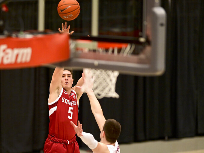 Stanford guard Michael O'Connell (5) attempts a 3-pointer as Washington State forward Andrej Jakimovski (23) defends during the first half of an NCAA college basketball game, Saturday, Feb. 20, 2021, in Pullman, Wash. (AP Photo/Pete Caster)