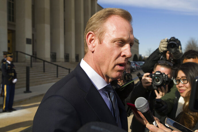 FILE - In this Jan. 28, 2019, file photo, acting Defense Secretary Pat Shanahan speaks with the media as he waits for the arrival of NATO Secretary General Jens Stoltenberg at the Pentagon in Washington. The Pentagon's top official, Shanahan, has arrived in Afghanistan to meet with U.S. commanders and Afghan leaders amid a push for peace with the Taliban. (AP Photo/Alex Brandon, File)