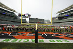 "The Cincinnati Bengals stand arm in arm as ""Lift Every Voice and Sing"" is played before an NFL football game between the Cincinnati Bengals and the Los Angeles Chargers, Sunday, Sept. 13, 2020, in Cincinnati. (AP Photo/Bryan Woolston)"
