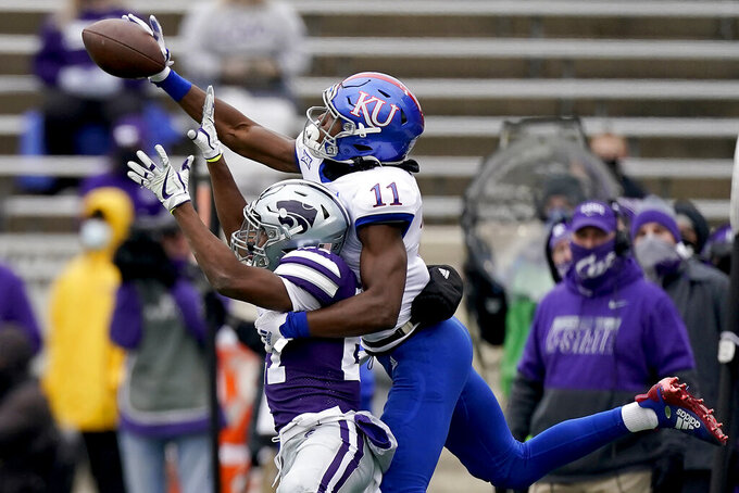 Kansas State defensive back Cameron Key (27) breaks up a pass intended for Kansas wide receiver Ezra Naylor II (11) during the second half of an NCAA football game Saturday, Oct. 24, 2020, in Manhattan, Kan. Kansas State won 55-14. (AP Photo/Charlie Riedel)