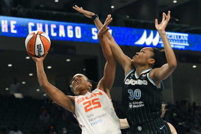 Connecticut Sun's Alyssa Thomas (25) goes up to shoot against Chicago Sky's Azura Stevens (30) during the first half of Game 3 in the semifinals of a WNBA playoff basketball game Sunday, Oct. 3, 2021, in Chicago. (AP Photo/Paul Beaty)