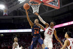 Auburn's Anfernee McLemore (24) drives to the basket past Arkansas defender Jimmy Whitt Jr.(33) during the second half of an NCAA college basketball game Tuesday, Feb. 4, 2020, in Fayetteville, Ark. (AP Photo/Michael Woods)