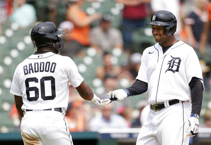 Detroit Tigers' Jonathan Schoop celebrates his two-run home run against the Minnesota Twins with Akil Baddoo (60) during the fifth inning of a baseball game Sunday, July 18, 2021, in Detroit. (AP Photo/Duane Burleson)