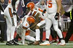 Cleveland Browns quarterback Baker Mayfield, left, is assisted from the turf by Ricky Seals-Jones after being tackled in the second half of an NFL football game against the New England Patriots, Sunday, Oct. 27, 2019, in Foxborough, Mass. (AP Photo/Steven Senne)