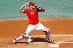 Philadelphia Phillies' J.T. Realmuto throws to second base during baseball practice at Citizens Bank Park, Monday, July 6, 2020, in Philadelphia. (AP Photo/Matt Slocum)