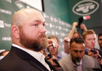 New York Jets general manager Joe Douglas speaks to reporters after a news conference at the team's NFL football training facility in Florham Park, N.J., Tuesday, June 11, 2019. (AP Photo/Seth Wenig)