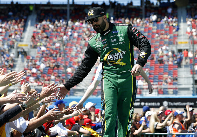 Paul Menard is greeted by fans during driver introductions prior to the start of the NASCAR Cup Series auto race at ISM Raceway, Sunday, March 10, 2019, in Avondale, Ariz. (AP Photo/Ralph Freso)