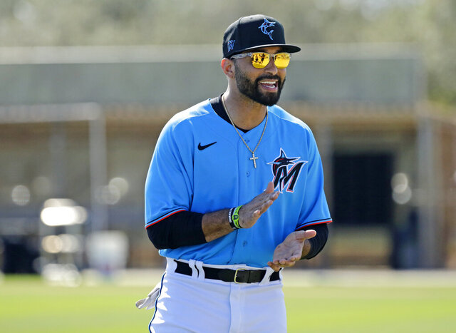 Miami Marlins outfielder Matt Kemp (27) looks on during spring training baseball practice in Jupiter, Fla., Monday, Feb. 17, 2020. (David Santiago/Miami Herald via AP)