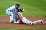 Detroit Tigers' Victor Reyes beats the tag attempt by Minnesota Twins shortstop Jorge Polanco to steal second base during the first inning of a baseball game Wednesday, Sept. 23, 2020, in Minneapolis. (AP Photo/Jim Mone)