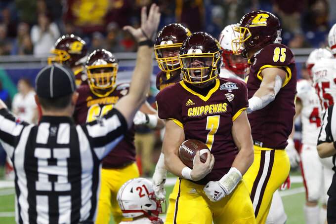 Central Michigan quarterback Tommy Lazzaro (7) reacts after scoring a touchdown during the second half of the Mid-American Conference championship NCAA college football game against Miami of Ohio, Saturday, Dec. 7, 2019, in Detroit. (AP Photo/Carlos Osorio)