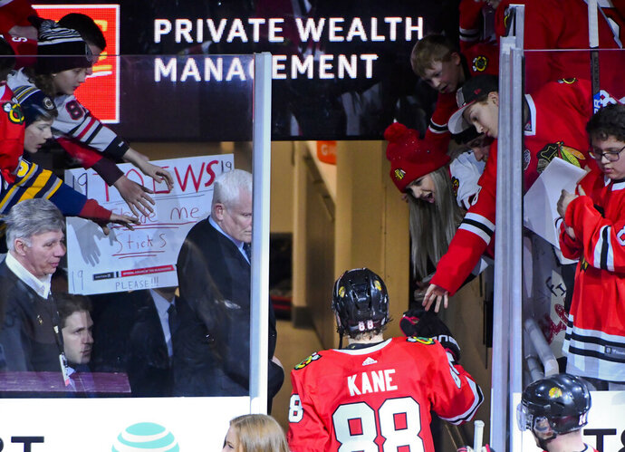 Chicago Blackhawks right wing Patrick Kane (88) is greeted by fans after an NHL hockey game against the Dallas Stars on Friday, April 5, 2019, in Chicago. (AP Photo/Matt Marton)