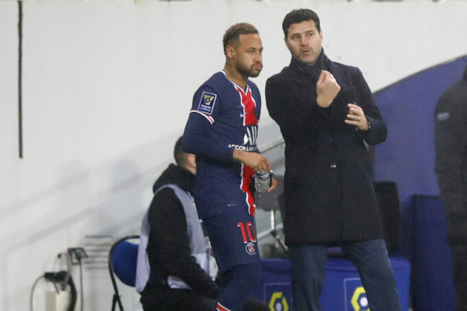 PSG's head coach Mauricio Pochettino, right, instructs PSG's Neymar during the Champions Trophy soccer match between Paris Saint-Germain and Olympique Marseille at the Bollaert stadium in Lens, northern France, Wednesday, Jan.13, 2021. (AP Photo/Christophe Ena)
