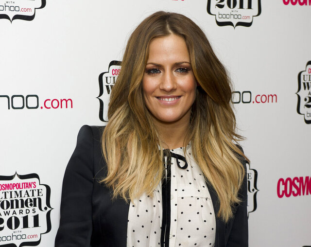 "FILE - In this file photo dated Thursday, Nov. 3, 2011, British TV personality Caroline Flack arrives for the Cosmopolitan Ultimate Women of the Year Awards in London.  The host controversial reality TV show ""Love Island,"" has died aged 40, according to a statement from her family Saturday Feb. 15, 2020. (AP Photo/Jonathan Short, FILE)"