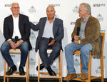 From left, Intrepid Heart and Spinoff trainer Todd Pletcher, left, sits beside War of Will trainer Mark Casse, center, and Tacitus trainer Bill Mott during a press conference following a draw ceremony for the 2019 Belmont Stakes race, Tuesday, June 4, 2019, in New York. (AP Photo/Kathy Willens)