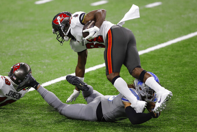 Tampa Bay Buccaneers wide receiver Antonio Brown (81) is stopped by Detroit Lions cornerback Darryl Roberts (29) during the first half of an NFL football game, Saturday, Dec. 26, 2020, in Detroit. (AP Photo/Al Goldis)