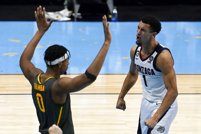 Gonzaga guard Jalen Suggs (1) celebrates in front of Baylor forward Flo Thamba (0) after making a basket during the second half of the championship game in the men's Final Four NCAA college basketball tournament, Monday, April 5, 2021, at Lucas Oil Stadium in Indianapolis. (AP Photo/Michael Conroy)
