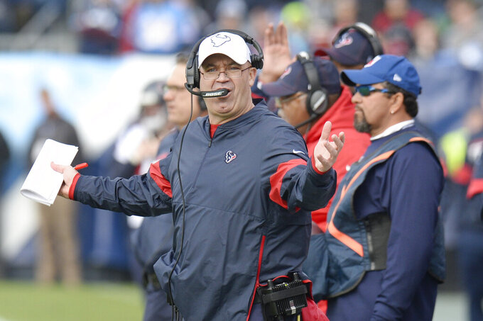 Houston Texans head coach Bill O'Brien objects to a call in the first half of an NFL football game against the Tennessee Titans Sunday, Dec. 15, 2019, in Nashville, Tenn. (AP Photo/Mark Zaleski)