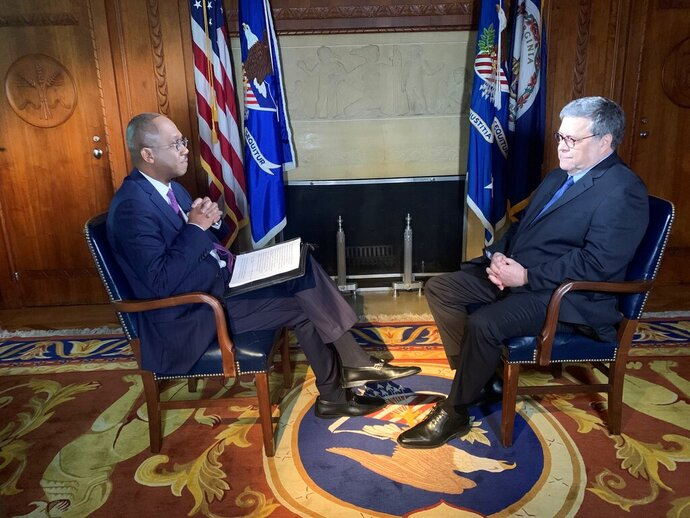 In this Thursday, Feb. 13, 2020 photo, Attorney General William Barr speaks to ABC News' Pierre Thomas during an interview in Washington, DC. (Luke Barr/ABC News via AP)