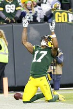 Green Bay Packers' Davante Adams celebrates his touchdown catch during the second half of an NFL divisional playoff football game against the Seattle Seahawks Sunday, Jan. 12, 2020, in Green Bay, Wis. (AP Photo/Mike Roemer)