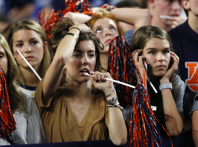 Auburn fans react at the end of a semifinal round game against Virginia in the Final Four NCAA college basketball tournament, Saturday, April 6, 2019, in Minneapolis. (AP Photo/Charlie Neibergall)