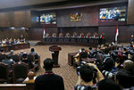 Judges preside over the final hearing on the court challenge to the results of April's presidential election at the Constitutional Court in Jakarta, Indonesia, Thursday, June 27, 2019. Former Gen. Prabowo Subianto who lost to the incumbent President Joko Widodo claims there was massive electoral fraud and is asking the Constitutional Court to invalidate the election. (AP Photo/Tatan Syuflana)