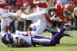 Kansas City Chiefs wide receiver Mecole Hardman (17) is tackled by Minnesota Vikings cornerback Mike Hughes, bottom, during the first half of an NFL football game in Kansas City, Mo., Sunday, Nov. 3, 2019. (AP Photo/Reed Hoffmann)