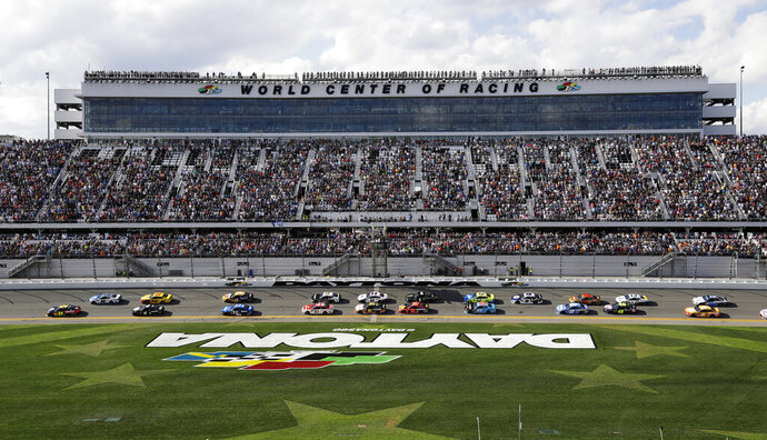 FILE - In this Feb. 17, 2019, file photo, William Byron (24) and Alex Bowman (88) lead the field at the start of a NASCAR Daytona 500 auto race at Daytona International Speedway in Daytona Beach, Fla. NASCAR made the first significant changes to its schedule in years by shuffling the 2020 season into a freshened new sequence that tries to meet the wants of fans to the best of NASCAR's current ability. (AP Photo/Chris O'Meara, File)