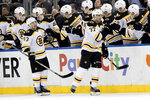 Boston Bruins center Patrice Bergeron (37) celebrates after scoring a goal in the second period of an NHL hockey game against the New York Rangers, Wednesday, Feb. 6, 2019, at Madison Square Garden in New York. (AP Photo/Mary Altaffer)