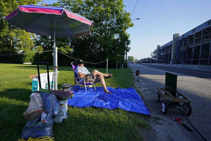 Andy Guthormsen sets up outside of the Indianapolis Motor Speedway, Sunday, Aug. 23, 2020, in Indianapolis. The Indianapolis 500 auto race is being held without fans. (AP Photo/Darron Cummings)