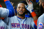 New York Mets' Robinson Cano celebrates his RBI sacrifice fly against the Minnesota Twins during the first inning of a baseball game Tuesday, July 16, 2019, in Minneapolis. (AP Photo/Bruce Kluckhohn)