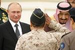 Russian President Vladimir Putin, left, and Saudi Arabia's King Salman, right, attend the official welcome ceremony in Riyadh, Saudi Arabia, Monday, Oct. 14, 2019. (AP Photo/Alexander Zemlianichenko, Pool)