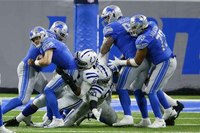 Detroit Lions quarterback Matthew Stafford is sacked by Indianapolis Colts defensive tackle Denico Autry (96) during the first half of an NFL football game, Sunday, Nov. 1, 2020, in Detroit. (AP Photo/Duane Burleson)