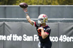 San Francisco 49ers first-round draft pick quarterback Trey Lance throws during the NFL football team's rookie minicamp in Santa Clara, Calif., Friday, May 14, 2021. (AP Photo/Tony Avelar)
