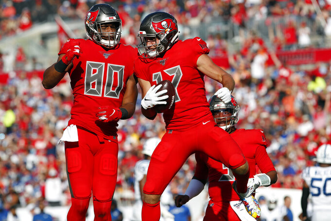 Tampa Bay Buccaneers wide receiver Justin Watson (17) celebrates his touchdown against the Indianapolis Colts with tight end O.J. Howard (80) during the second half of an NFL football game Sunday, Dec. 8, 2019, in Tampa, Fla. (AP Photo/Mark LoMoglio)