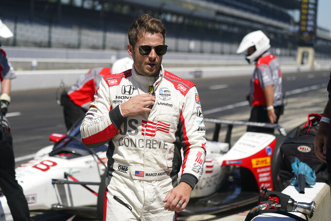 FILE - Marco Andretti walks in the pits during the final practice session for the Indianapolis 500 auto race at Indianapolis Motor Speedway, in this Friday, Aug. 21, 2020, file photo. Marco Andretti will not run a full IndyCar schedule in 2021 as last year's Indianapolis 500 pole-winner said he's reprioritizing his racing. He's still expected to compete in the Indy 500.(AP Photo/Darron Cummings, File)
