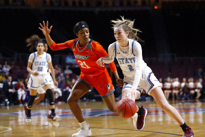 New Mexico State guard Brooke Salas (2) drives past Texas-Rio Grande Valley forward Krisynthia Sampson (21) during a NCAA college basketball Western Athletic Conference Women's Tournament championship game Saturday, March 16, 2019, in Las Vegas. (AP Photo/Steve Marcus)