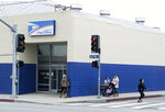 This March 1, 2019 photo shows the Pacoima post office in Los Angeles' San Fernando Valley. President Donald Trump has signed resolutions renaming two post offices in Southern California in honor of Marilyn Monroe and rock 'n' roll legend Ritchie Valens. The Los Angeles Daily News reported Thursday, Dec. 12, 2019 that the Pacoima post office will be named the Ritchie Valens Post Office Building. (Dean Musgrove/The Orange County Register via AP)