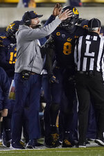 California coach Justin Wilcox, left, reacts with linebacker Kuony Deng (8) during the first half of the team's NCAA college football game against Oregon in Berkeley, Calif., Saturday, Dec. 5, 2020. (AP Photo/Jeff Chiu)