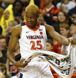 Virginia forward Mamadi Diakite (25) celebrates a play against Pittsburgh during the first half of an NCAA college basketball game in Charlottesville, Va., Saturday, March 2, 2019. (AP Photo/Steve Helber)