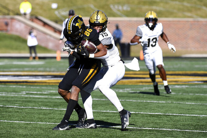 Missouri wide receiver Tauskie Dove (86) catches a pass as Vanderbilt cornerback Elijah Hamilton (15) defends during the first half of an NCAA college football game Saturday, Nov. 28, 2020, in Columbia, Mo. (AP Photo/L.G. Patterson)