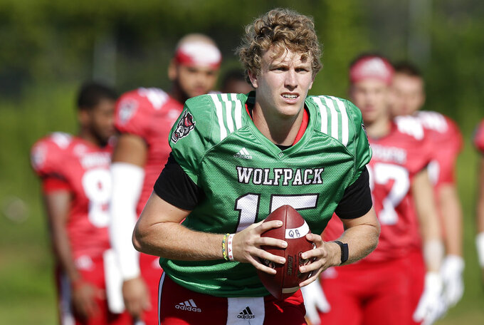 In this photo taken Thursday, Aug. 9, 2018, North Carolina State quarterback Ryan Finley runs through a drill during an NCAA college football practice in Raleigh, N.C. (AP Photo/Gerry Broome)