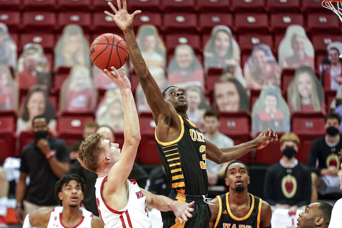 Wisconsin's Tyler Wahl (5) shoots as Arkansas-Pine Bluff's Markedric Bell (3) defends during the second half of an NCAA college basketball game Friday, Nov. 27, 2020, in Madison, Wis. Wisconsin won 92-58. (AP Photo/Andy Manis)