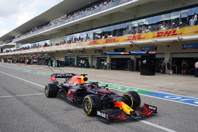 Red Bull driver Max Verstappen, of the Netherlands, leaves the pits during qualifications for the F1 U.S. Grand Prix auto race at the Circuit of the Americas, Saturday, Oct. 23, 2021, in Austin, Texas. (AP Photo/Darron Cummings, Pool)