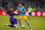 Orlando City defender Antonio Carlos, left, stops Philadelphia Union defender Kai Wagner (27) from advancing the ball during the second half of an MLS soccer match, Thursday, July 22, 2021, in Orlando, Fla. (AP Photo/John Raoux)