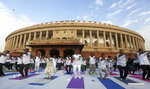 Indian lawmakers perform yoga in front of the parliament house to mark International Yoga Day in New Delhi, India, Friday, June 21, 2019. Yoga enthusiasts across the world Friday took part in mass yoga events to mark International Yoga Day. (AP Photo)