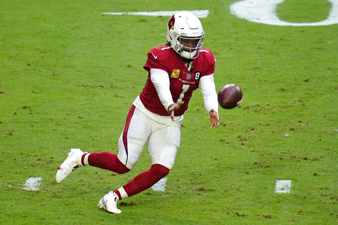 Arizona Cardinals quarterback Kyler Murray (1) hands off against the Miami Dolphins during the first half of an NFL football game, Sunday, Nov. 8, 2020, in Glendale, Ariz. (AP Photo/Ross D. Franklin)